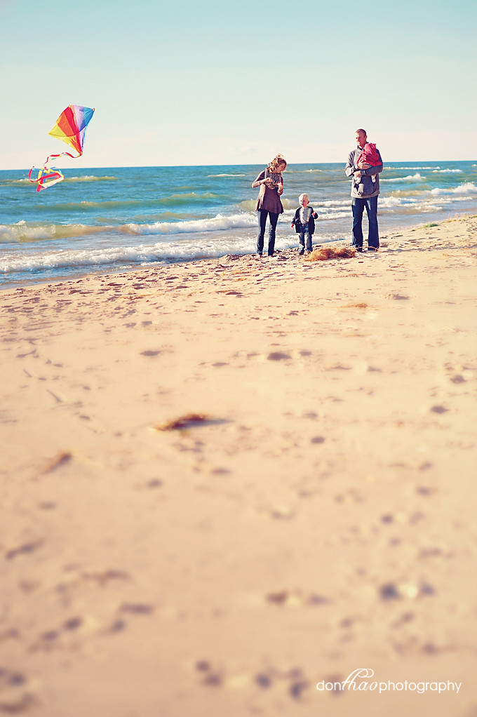 family with kite on West Michigan beach photography