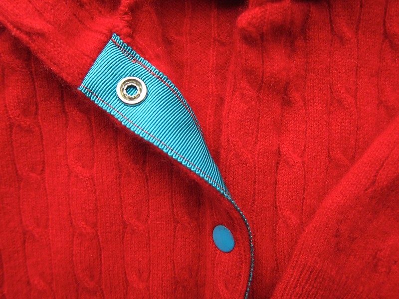 Red baby cashmere hoodie cardigan closeup