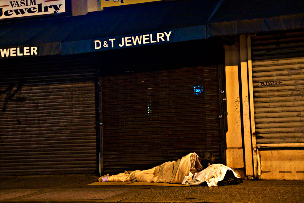 Man-sleeping-outside-jewely-store-on-Christmas-Eve-of-2014--Center-City