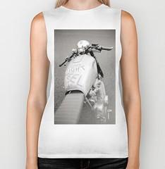 neck(0.0), sleeve(0.0), human body(0.0), t-shirt(0.0), pattern(1.0), arm(1.0), textile(1.0), clothing(1.0), white(1.0), sleeveless shirt(1.0), photo shoot(1.0),