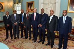U.S. Secretary of State John Kerry poses for photo with the Djiboutian delegation led by Foreign Minister Mahamoud Ali Youssouf before participating in the U.S.-Djibouti Bi-National Forum at the U.S. Department of State in Washington, D.C., on February 26, 2015. [State Department photo/ Public Domain]