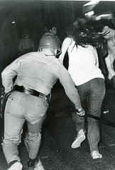 Police swings baton at fleeing UMD demonstrator: 1970