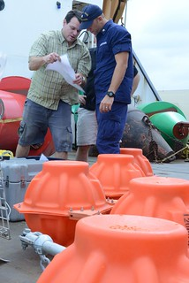 Petty Officer 2nd Class John Thompson, a boatswain's mate aboard the Coast Guard Cutter Sequoia, and Dr. Joe Haxel, a research assistant with the National Oceanic and Atmospheric Administration, prepare special floats used to deploy a hydrophone in Challenger Deep near the Federated States of Micronesia, Jan. 11, 2015. The crew of the Sequoia and NOAA scientists deployed the hydrophone in an attempt to listen to ambient sound in the deepest part of the Challenger Deep. (U.S. Coast Guard photo by Petty Officer 2nd Class Tara Molle)