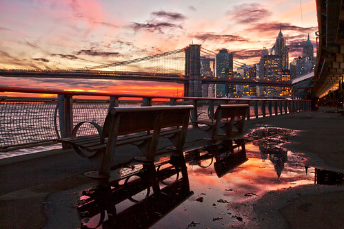 park nyc newyorkcity bridge light sunset sky urban sun color reflection skyline clouds fence buildings river twilight cityscape manhattan landmark brooklynbridge eastriver benches puddles fdrdrive