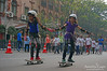 """Girls on Skate Board at """"Happy Streets"""""""
