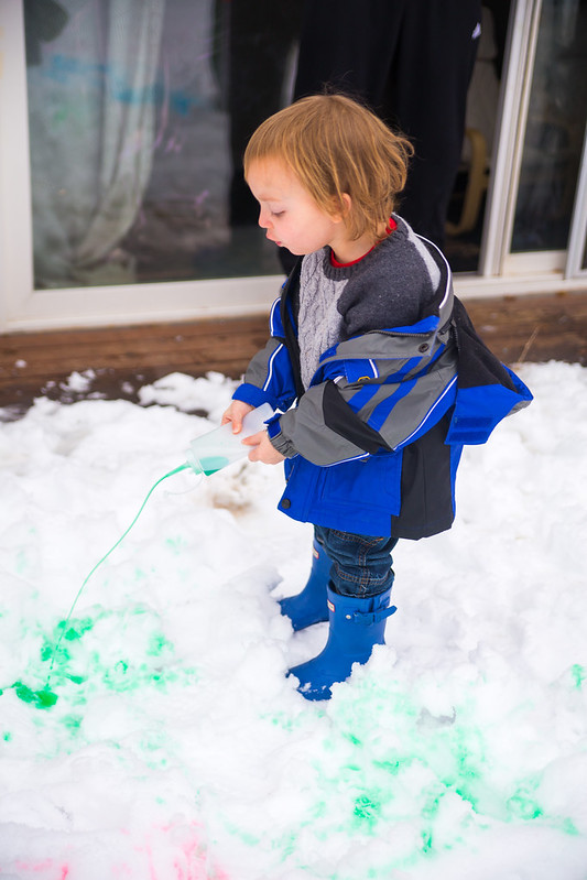 Toddler Painting in the Snow