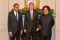 U.S. Secretary of State John Kerry poses for a photo with U.S. Ambassador to India Rich Verma and Indian Embassy to the U.S. Deputy Chief of Mission, Ambassador Taranjit Singh Sandhu, at Ambassador Verma's swearing-in ceremony at the U.S. Department of State in Washington, D.C.,  on December 19, 2014. [State Department photo/ Public Domain]