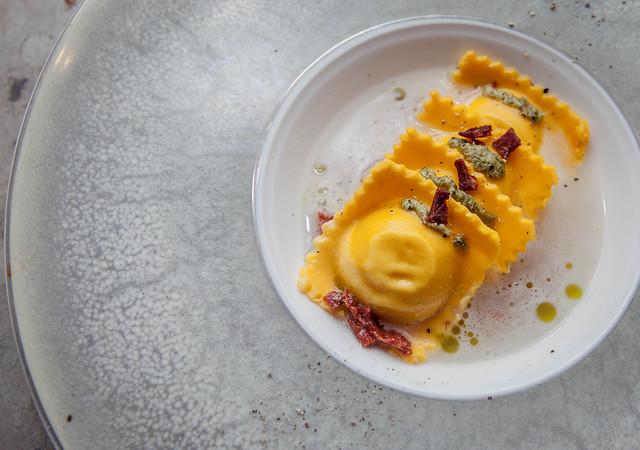 ravioli di patate in brodo di parmigiano
