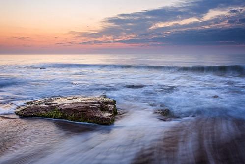 beach sunrise rocks northcarolina ftfisher