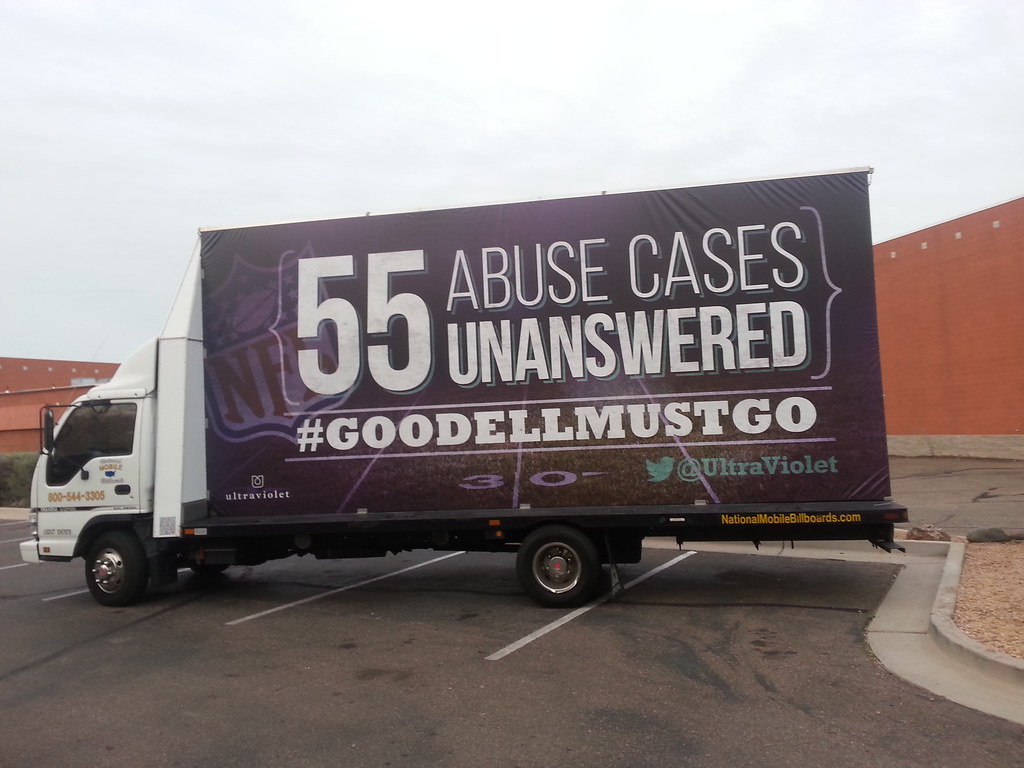 "An ad on the side of a truck reads ""55 unanswered cases of abuse. Goodell must go."""