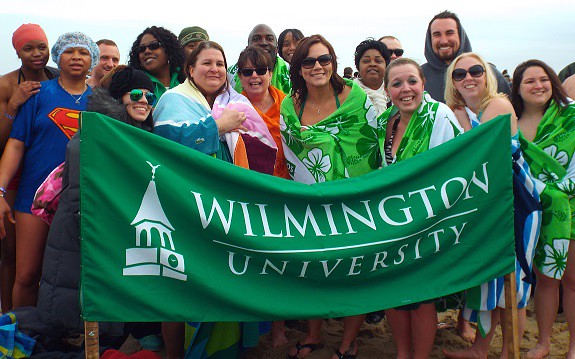 Seventeen intrepid Wilmington University Pi Gamma Mu members and alumni braved the Atlantic's frigid waters with nearly 4,000 others who
