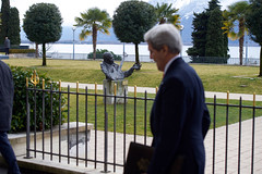 U.S. Secretary of State John Kerry passes a bust of blues guitarist B.B. King in Montreux, Switzerland, home of the annual Montreux Jazz Festival, after concluding a meeting on March 4, 2015, with Iranian Foreign Minister Javad Zarif about the future of his country's nuclear program. [State Department photo/ Public Domain]