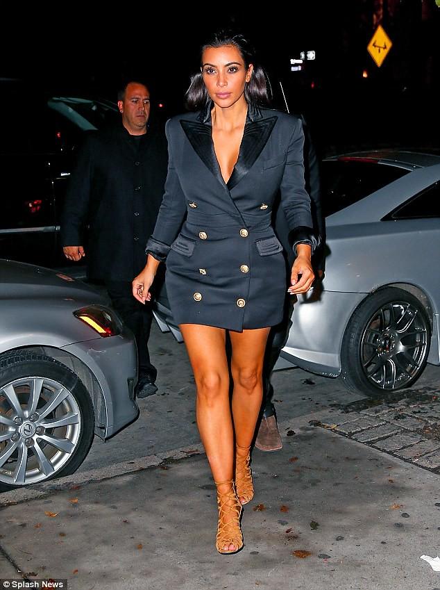 KIm-Kardashian-Balmain-Resort-2015-tuxedo-dress,tuxedo-style dress, sleeveless blazer-style dress,  double breasted dress blazers double breasted tuxedo dress, Haute Hippie White Tuxedo Wrap Dress, Tuxedo Wrap Dress, tuxedo dress,  a white sleeveless blazer-style mini dress