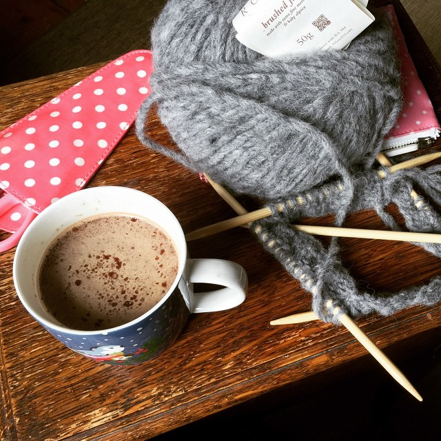 Tagged by my fellow knitting, sewing, newly-qualified nurse, @lilyboot, to show you what's in my cup and on my needles right now: mocha in a Christmas mug (fresh coffee with a spoonful of hot chocolate stirred in), and a soft grey beanie hat for me.  I ta