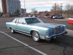 lincoln motor company(0.0), cadillac brougham(0.0), automobile(1.0), automotive exterior(1.0), lincoln mark series(1.0), vehicle(1.0), full-size car(1.0), lincoln continental mark v(1.0), lincoln continental(1.0), sedan(1.0), classic car(1.0), land vehicle(1.0), luxury vehicle(1.0), coupã©(1.0),