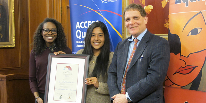 Carissa Gordon, ConEd'16, and Stefanny Sanchez, Com'15, accepted the Human Rights Initiative Award from Principal Woolf on behalf of the African and Caribbean Students Association.