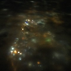 What is this surreal photo? The tallest buildings on downtown Atlanta's skyline are piercing the dense layer of fog while the random glow of lights from the rest of the city create a patchwork quilt of muted colors as seen from a @Delta flight earlier ton