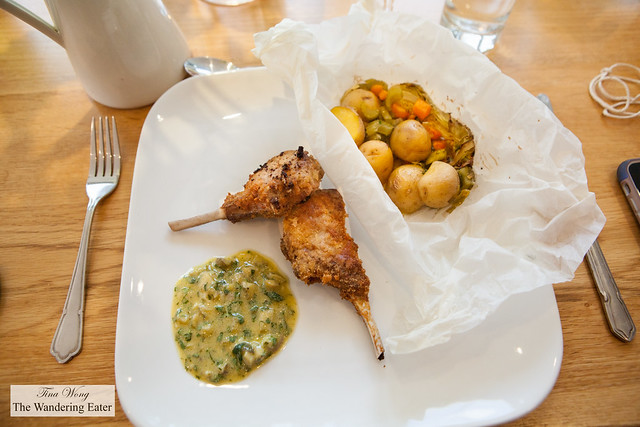 Fried stuffed lamb chops with a version of salsa verde and the vegetables en papillote