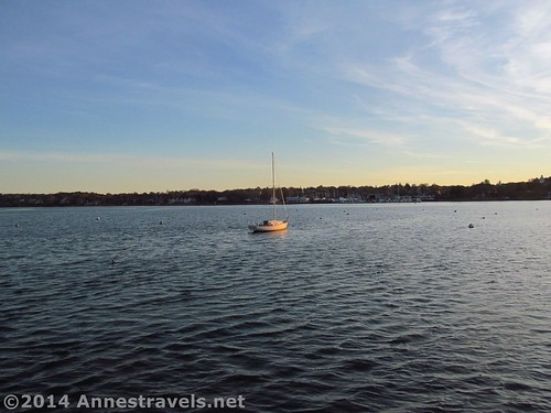 A lone boat anchors in the cold November waters of Plymouth Bay, MA