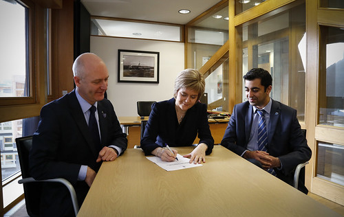Nicola Sturgeon signing nomination form to be First Minister