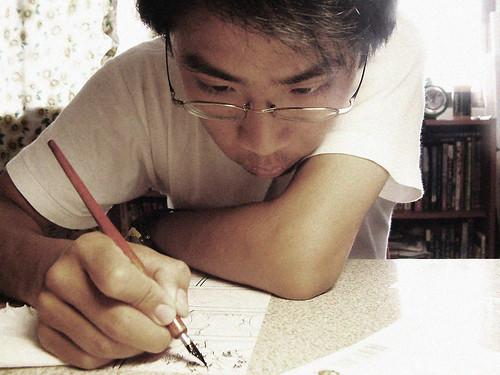 大四志工繪製北鳥會刊漫畫專欄。(圖片來源:李政霖)