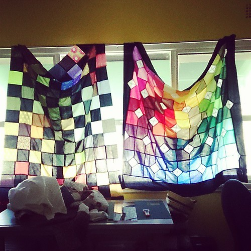 I really need to make some real curtains. Although this is a good reminder of what still needs backing and quilting!
