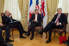 U.S. Secretary of State John Kerry sits with French Foreign Minister Laurent Fabius and British Foreign Secretary Philip Hammond after all three gathered in Vienna, Austria, on November 21, 2014, for multilateral discussions about the future of Iran's nuclear program. [State Department photo/ Public Domain]