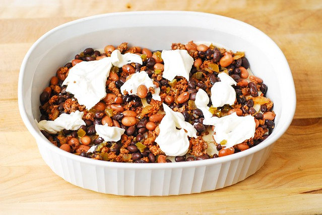 Top the meat mixture with sour cream