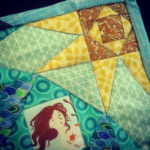 Sewing mermaids on the train.