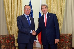 U.S. Secretary of State John Kerry shakes hands with Russian Foreign Minister Sergey Lavrov in Vienna, Austria, on November 23, 2014, before the two begin a bilateral meeting amid broader negotiations about the future of Iran's nuclear program. [State Department photo/ Public Domain]