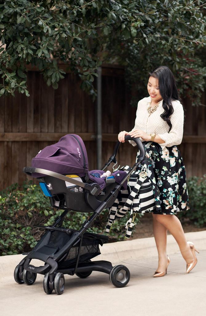 https://cuteandlittle.com | petite fashion lifestyle blog | polka dot shirt, floral pleated skirt, rose gold pumps | nuna pipa pepp stroller travel system | spring feminine outfit