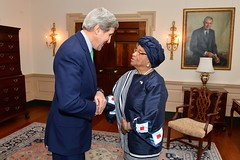 U.S. Secretary of State John Kerry greets Liberian President Ellen Johnson Sirleaf before their meeting at the U.S. Department of State in Washington, D.C., on February 27, 2015. [State Department photo/ Public Domain]