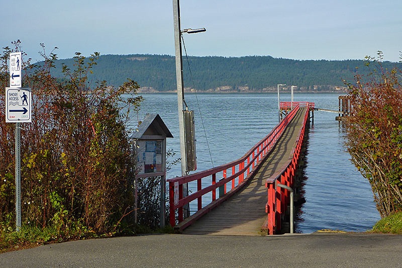 Fernwood Point Government Dock, Fernwood, Saltspring Island, Gulf Islands, British Columbia, with Galiano Island in the background.