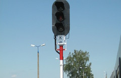 signage(0.0), sign(0.0), street sign(0.0), mast(0.0), traffic sign(0.0), tower(0.0), advertising(0.0), light fixture(1.0), signaling device(1.0), street light(1.0), lighting(1.0), traffic light(1.0),