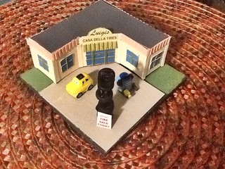 Luigi's Casa Della Tires.  N scale building scratchbuilt from cardboard.  Lungi and Guido are Squinkies toys.