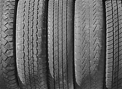 rim(0.0), bumper(0.0), tire(1.0), automotive tire(1.0), tire care(1.0), automotive exterior(1.0), wheel(1.0), synthetic rubber(1.0), tread(1.0), monochrome(1.0), black-and-white(1.0),