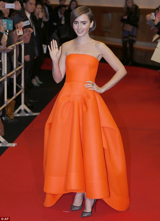 Lily-Collins-in-orange-strapless-gown-from-Maticevski-Resort-2015,how to dress up tracksuits, tracksuit, slogan tracksuit, black-and-white tracksuit, orange long-sleeved maxi dress