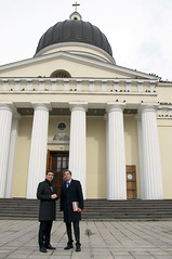 With the Metropolitan Cathedral of Chisinau in the background, Deputy Secretary of State Antony 'Tony' Blinken receives a tour of the Moldovan capital on March 3, 2015. [State Department photo/ Public Domain]