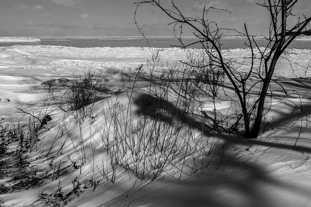 Shadows in the snow and ice along the shore of Lake Ontario.