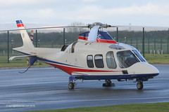 G-LCFC - 2009 build Agusta A109S Grand, pictured at City Heliport during a brief hail shower
