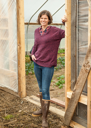 Lindsey Lusher Shute stands outside her hoop house at Hearty Roots Community Farm in New York's Hudson Valley. Photo Credit: Joshua Simpson Photography.