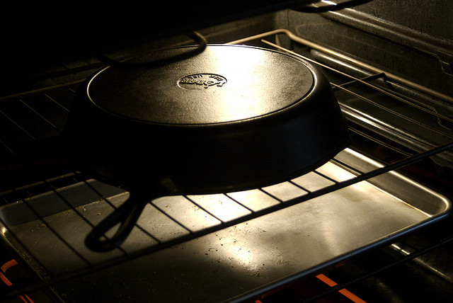 Seasoning a cast iron pan in the oven by Joelle van Dyne