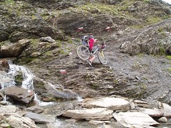 Difficult river crossing with a bike Image
