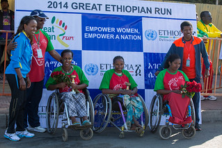 Dr Pierre M'pele-Kilebou, WHO Representative and world renown atheletes Haile Gebreselassie and Meseret Defar take group photo with winners of women mobility race.