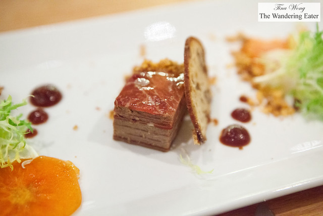 Foie gras millefeuille, persimmon, Serrano ham, pink peppercorn, and hazelnut crumble