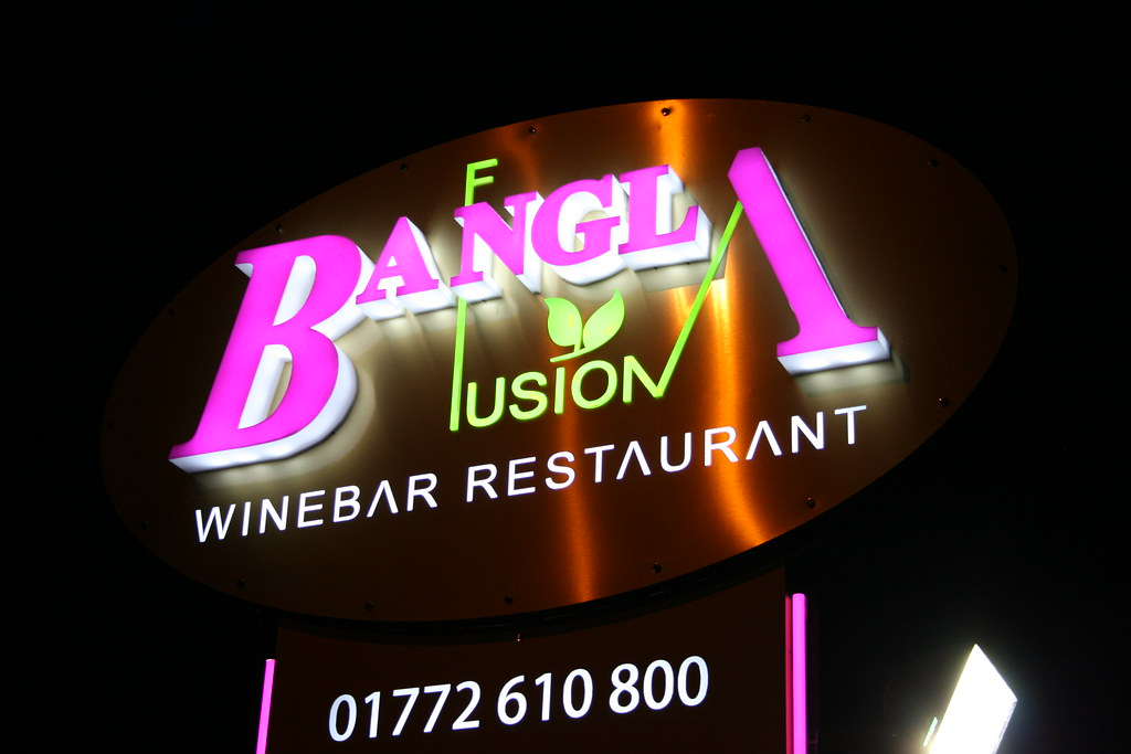 Brushed gold DiBond aluminium composite fret cut sign trays (oval and rectangles), built up 3D acrylic letters and faux neon effect text and trim. All with internal LED illumination,