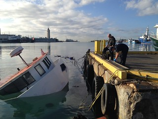 The Coast Guard and Hawaii Department of Transportation are responding to a diesel fuel spill from a sunken vessel in Honolulu Harbor, Jan. 12, 2015. Fishing vessel Judy K is a derelict vessel that is the possession of the State of Hawaii. (U.S. Coast Guard photo by Petty Officer 1st Class Chad Pendarvis)
