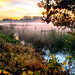 Misty sunset flooded ditch by chrisbussicott
