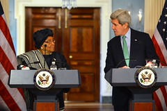 U.S. Secretary of State John Kerry listens as Liberian President Ellen Johnson Sirleaf addresses reporters during their joint news conference at the U.S. Department of State in Washington, D.C., on February 27, 2015. [State Department photo/ Public Domain]