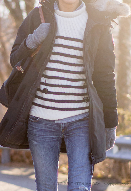 black parka, striped sweater, chambray shirt, gray gloves